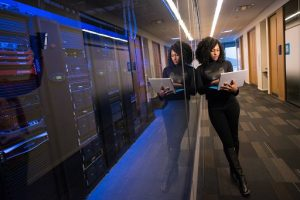 Woman Standing by Web Servers
